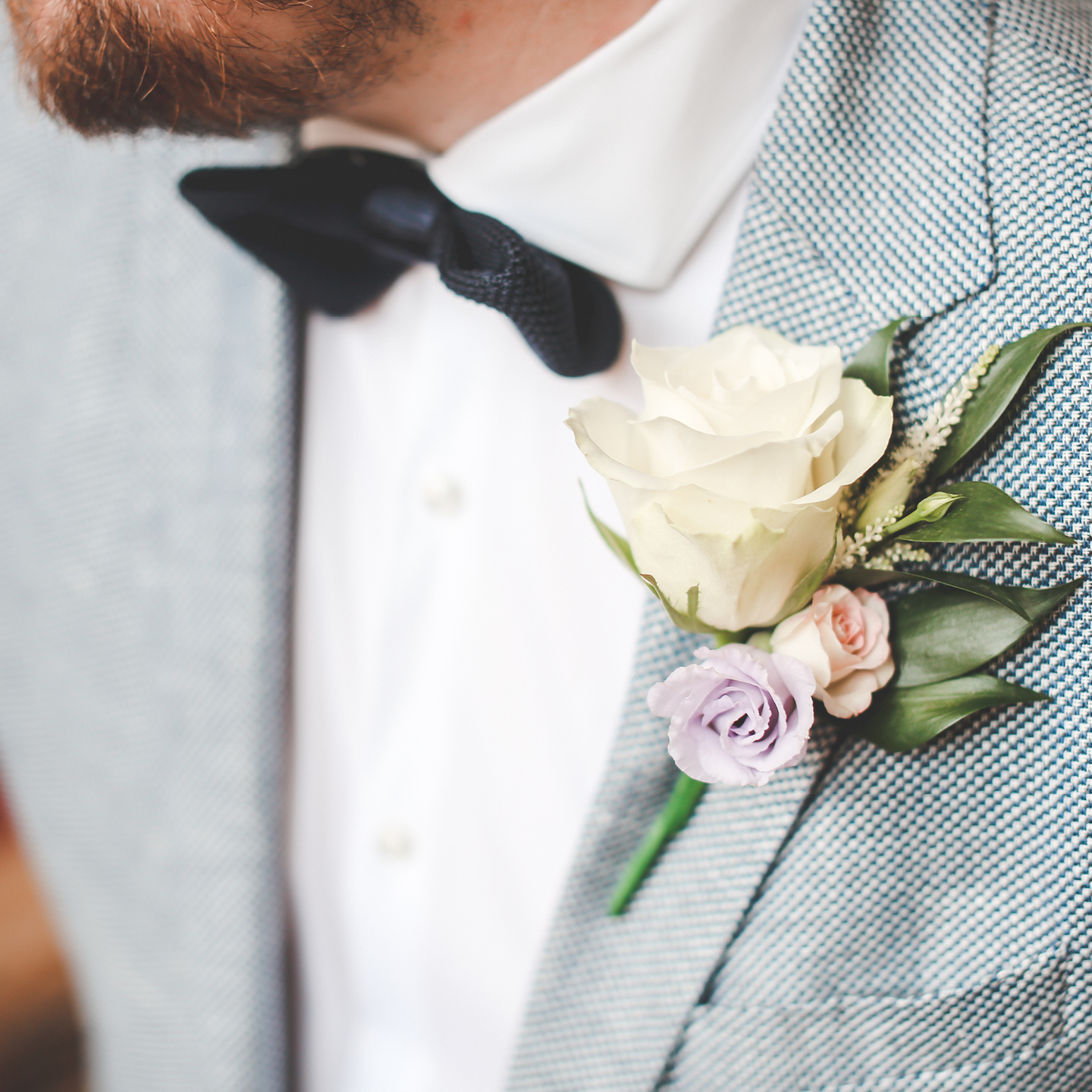 Difference between buttonhole and corsage spring wedding bouquet